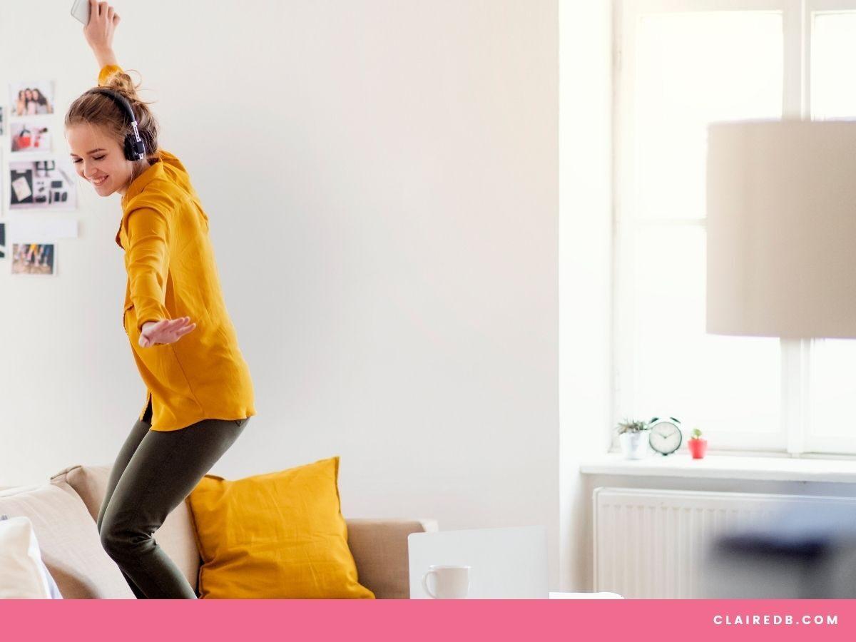 Self Love Ritual - girl dancing on sofa